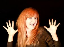 Free Young Red-haired Girl Smiling On A Dark Background Royalty Free Stock Images - 18302479