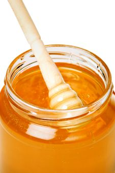 Jar Of Honey With Wooden Dipper Stock Photo