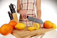 Free Cutting Lemon With The Knife Royalty Free Stock Photos - 18304088