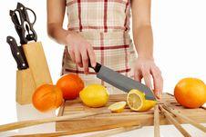 Free Girl Cutting Lemon In Slices 2 Stock Photo - 18304170