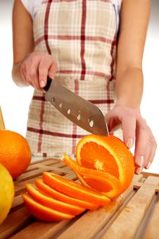 Girl Cutting Orange Royalty Free Stock Images