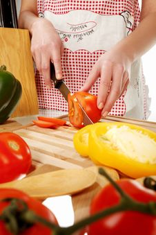Free Tomato Cutting On A Wooden Plate Royalty Free Stock Photography - 18304627