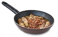 Free Frying Pan With Buckwheat Porridge And Cannelons Stock Images - 18304944