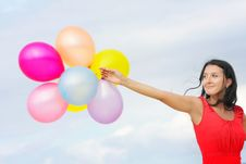 Young Attractive Woman With Colorful Balloons Royalty Free Stock Image