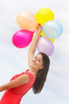 Young Attractive Woman With Colorful Balloons Royalty Free Stock Images
