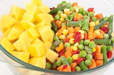 Potatoes And Frozen Mixed Vegetables Royalty Free Stock Photography