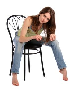 Free Girl Sit On Stool Bend Forward. Royalty Free Stock Photo - 18313375