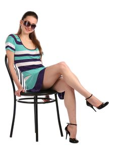 Free Girl With Eyeglasses Sits On Stool. Stock Photography - 18313492
