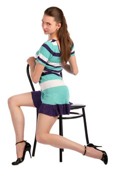 Free Girl In Stripy Blue Dress Sit On Stool Turned. Royalty Free Stock Images - 18313509