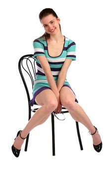 Free Girl In Stripy Blue Dress Sits On Stool Smiling. Royalty Free Stock Photo - 18313525