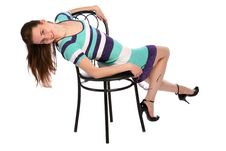 Free Girl In Stripy Blue Dress Bend Back On Stool. Stock Images - 18313574