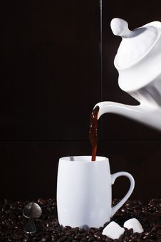 Free Pouring Hot Coffee To A Cup Stock Photos - 18313583
