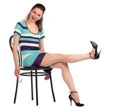 Free Girl Take Leg Up Sitting On Stool. Royalty Free Stock Photos - 18313588