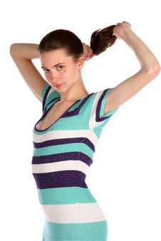 Free Girl In Stripy Blue Dress Holds Her Hairs. Royalty Free Stock Photography - 18313827