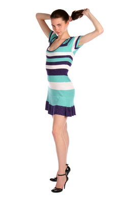 Free Girl In Stripy Blue Dress Holds Her Hairs. Royalty Free Stock Images - 18313849