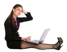 Free Girl Sits On Floor With Notebook And Thinks. Royalty Free Stock Photos - 18314668