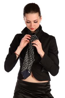 Free Girl In Black Suit Makes Necktie. Stock Photos - 18315353