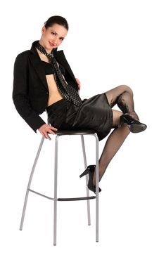 Girl In Black Suit Sits On Stool Cross Legs. Stock Photos