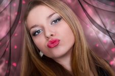 Free Kiss Of A Beautiful Young Woman Royalty Free Stock Photography - 18316677