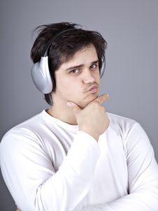 Young Doubt Men With Headphone. Stock Photo