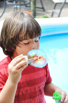 Free Little Boy Blowing Bubbles Royalty Free Stock Images - 18319339