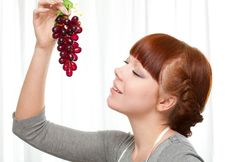 Free Ginger Housewife Holding Grape Stock Images - 18322834