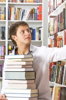 Free Young Man Choosing Books Stock Photo - 18323480