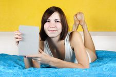 Woman Lying In Bed On Belly And Showing Book Royalty Free Stock Photo