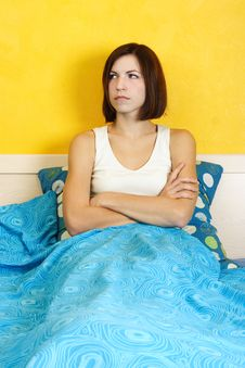 Woman In White Shirt Sitting On Bed Stock Image