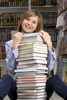 Free Woman Sitting With Stack Of  Books Royalty Free Stock Images - 18323789