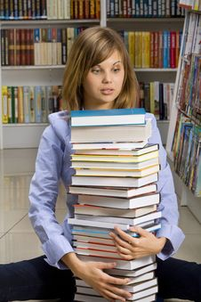 Free Woman Sitting With Stack Of  Books Stock Photo - 18323820
