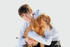 Free Cute  Teen Boy Smiling With Dog Royalty Free Stock Image - 18323836