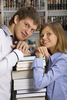 Free Young Couple In The Booksop Stock Photos - 18323903