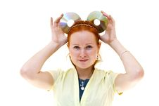 Redhead Young Woman Holding A CDs Royalty Free Stock Image