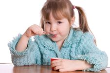 Free The Little Girl Eats Yoghurt Stock Photos - 18326083