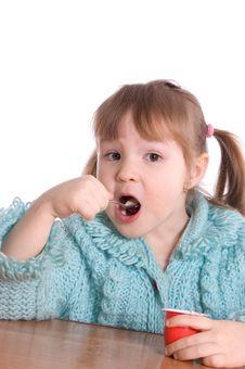 Free The Little Girl Eats Yoghurt Royalty Free Stock Photo - 18326085