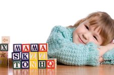 The Little Girl Plays Cubes Stock Photo