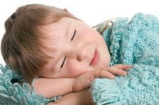 Free Little Girl Sleeps On A Table Royalty Free Stock Photography - 18326107