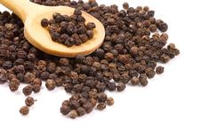 Black Peppercorns On A Wooden Spoon Royalty Free Stock Photo