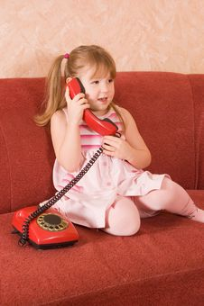 Free The Little Girl Speaks On The Phone Royalty Free Stock Photos - 18326178