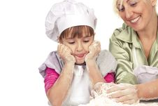Mother And Daughter Preparing Dough Stock Images