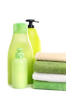 Free Towels And Green Plastic Bottles Royalty Free Stock Photography - 18332897