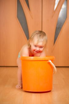 Free Adorable Baby Washing Rug In Orange Pail Royalty Free Stock Photos - 18333688