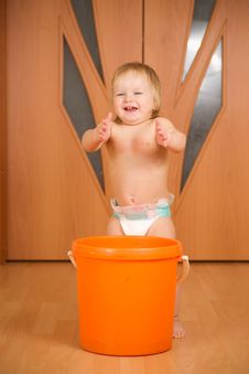 Free Happy Baby Applause Staying Near Orange Pail Stock Image - 18333711