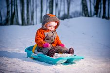 Serious Baby Sliding On Sleigh From Hill Stock Image
