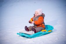 Adorable Baby Sliding On Sleigh From Hill Royalty Free Stock Photos