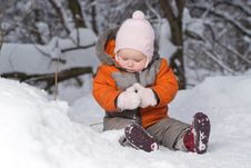 Cute Baby Sit On Snow In Forest And Dig Snow Royalty Free Stock Photos