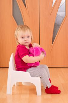 Adorable Baby Sit On Toilet Chair With Toy Royalty Free Stock Photos