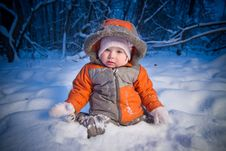 Adorable Baby Sit In Deep Snow Stock Photo