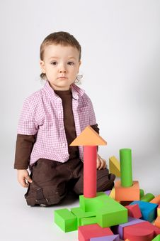 Free Little Cute Boy Plays With Cubes Stock Image - 18335711